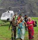 Army personnel rescue pilgrims in flood-hit areas of Chamoli district.