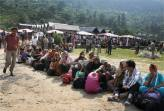 Pilgrims rescued by the Army wait to board helicopters at Gauri Kund. It was among the worst affected areas.