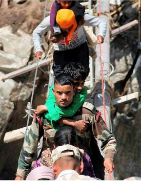 Army personnel rescue pilgrims at Tawaghat in rain-battered Uttarakhand on Saturday.