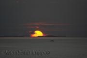 Sun setting in sea close to Male, Maldives