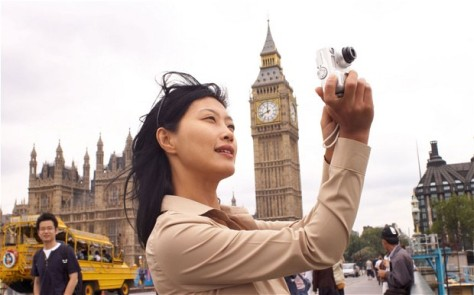 A Chinese tourist in Britain capturing a photo