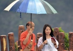 Saving 'her excellency' from raindrops!