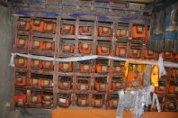 225 volumes of Tangyur wrapped in silk and stored in wooden shelves